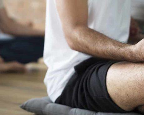 Men practicing yoga. NRhythm offers healing programs that promote sober living in Nashville, TN.